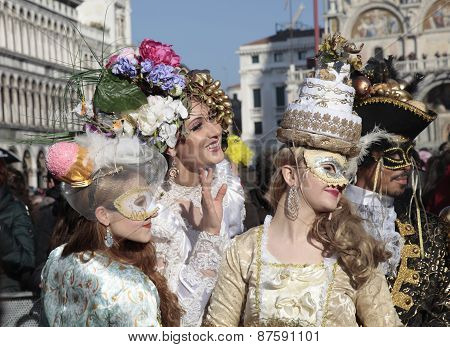 Masked Persons In Beautiful Ornate Costume On San Marco Square, Venice, Italy.