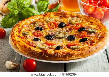 Pizza With Bacon, Olives And Jalapeno Pepper