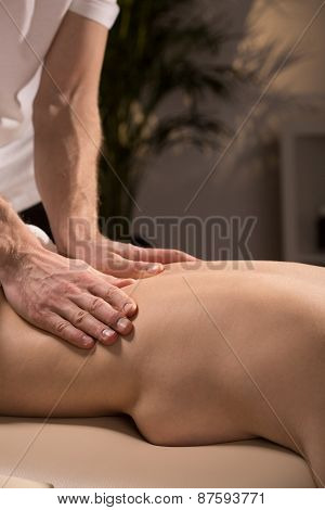 Masseur Massaging Naked Woman