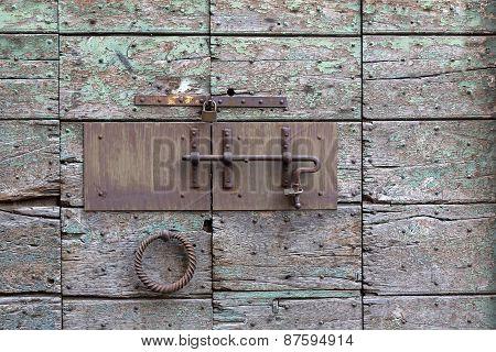 Locked wooden weathered door