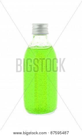 Close Up Of Medicine Bottle With Green Syrup Isolated On White