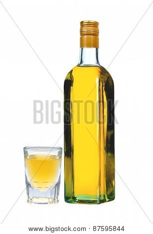 Bottle Of Vodka With Pepper And Glass Isolated On White