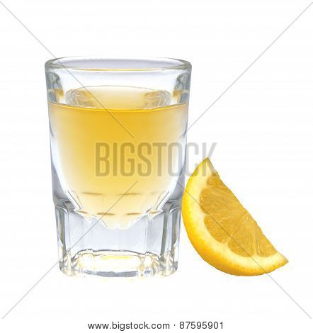 Glass Of Vodka With Pepper And Lemon Slice Isolated On White