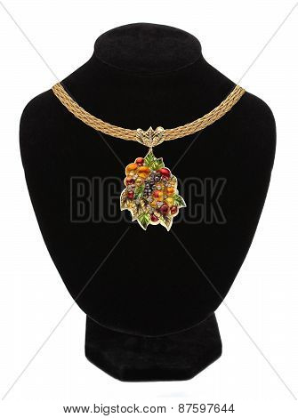 Pendant With Colorful Gem On Mannequin Isolated On White