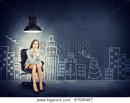 Businesswoman on Chair by Drawn City Skyline