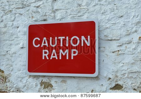 Red caution traffic ramp sign