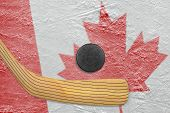 pic of hockey arena  - Hockey puck hockey stick and Canadian flag image on ice - JPG
