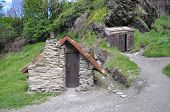 pic of primitive  - Arrowtown near Queenstown Otago New Zealand is the best example of a goldrush era miners settlement These Chinese gold diggers arrived during the 1860