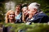 foto of senior-citizen  - An elderly man telling stories to a group of young people