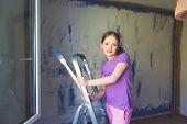 picture of step-ladder  - Little girl sitting on step ladder - JPG