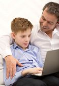 pic of father time  - Boy spending time with laptop - JPG