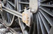 image of locomotive  - Detail view of old steam locomotive wheels - JPG