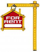 picture of house rent  - Yellow wooden meter ruler in the shape of house with text for rent - JPG