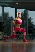 picture of squatting  - Middle Age Woman Performing Dumbbell Squats - One Of The Best Body Building Exercise For Legs ** Note: Soft Focus at 100%, best at smaller sizes - JPG