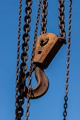 picture of crane hook  - Chains and crane hook to carry the load against the blue sky - JPG