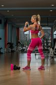 image of jump rope  - Middle Age Womane Playing Around With Jumping Rope As Part Of Bodybuilding Training - JPG