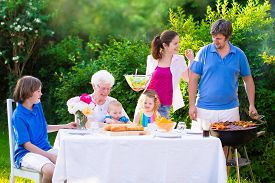 foto of grandmother  - Grill barbecue backyard party - JPG