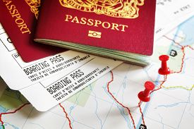 stock photo of aeroplan  - Boarding pass and passport on map with thumbtack concept for travel and vacations - JPG