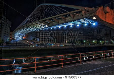 Zubizuri Bridge over Nevion River in Bilbao, Spain at night
