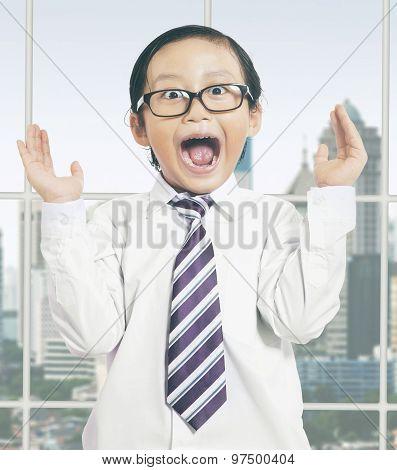 Little Businessman Looks Shocked In Office