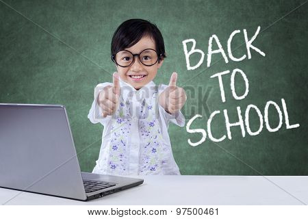 Lovely Child Back To School And Show Ok Sign