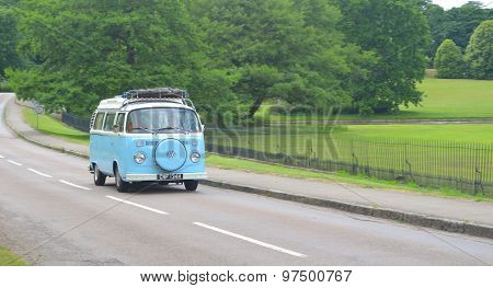 Classic VW Camper Van on country road.
