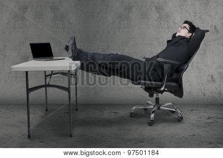 Manager Relaxing On Chair While Daydreaming