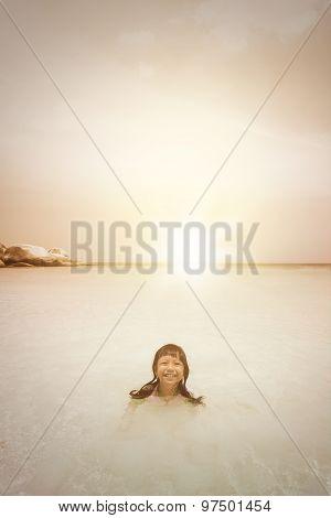 Playful Girl Swimming On Beach At Dusk