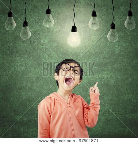 Smart Girl Standing Under Bright Light Bulb