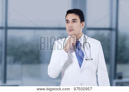 Thoughtful Doctor With Hand On Chin