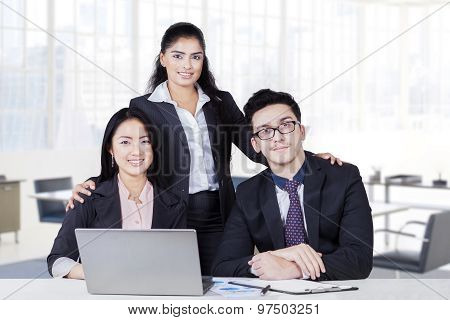 Three Multi Ethnic Business Team Smiling In Office