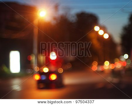 Cars With Headlights On Driving On City Road