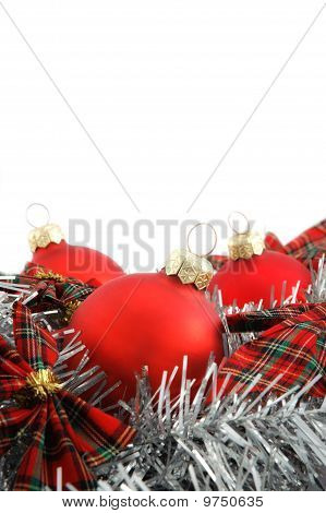 Three Red Christmas Balls With Check Ribbon On White Background