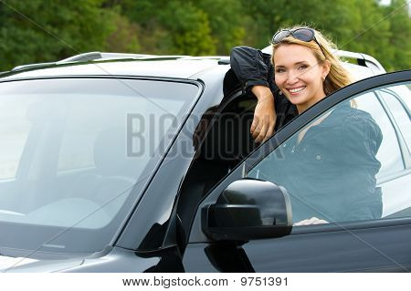 Attractive Woman In The New Car