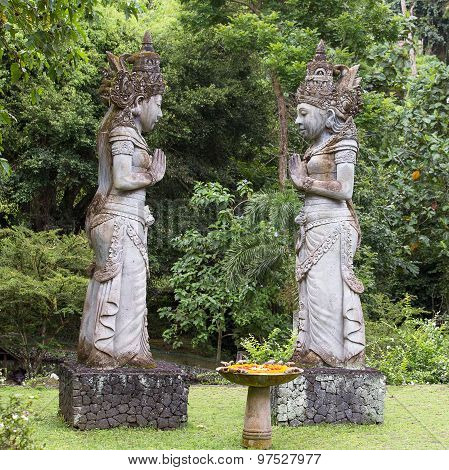Traditional Stone Sculpture In Garden . Island Bali, Ubud, Indonesia