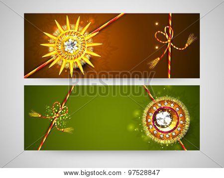 Beautiful shiny rakhi decorated website header or banner set for Indian festival, Happy Raksha Bandhan celebration.