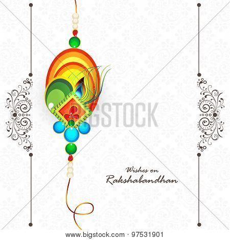 Colorful creative rakhi on shiny background for Indian festival of brother and sister love, Happy Raksha Bandhan celebration.
