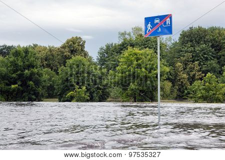 GDANSK, POLAND - July 28: Road sign submerged in flood water on July 28, 2015 in Gdansk, Poland. Storms and heavy rains hit many parts of Poland and Europe