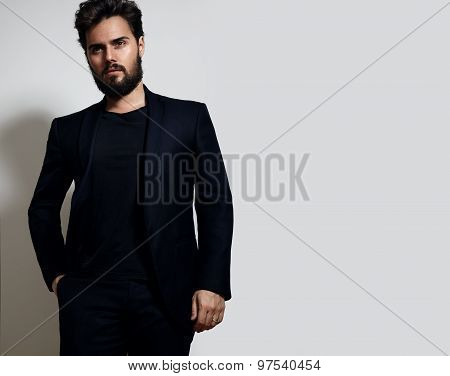 Elegant Man In A Suit On A White Wall