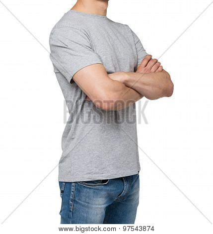 Side View Of The Young Man In A Grey T-shirt With Crossed Hands. Isolated.