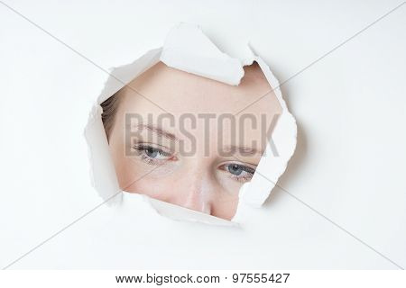 young woman peeking