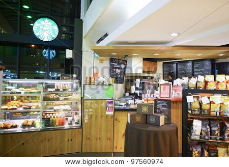 HONG KONG, CHINA - FEBRUARY 04, 2015: Starbucks Cafe interior. Starbucks Corporation is an American global coffee company and coffeehouse chain based in Seattle, Washington