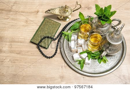 Islamic Holidays Decoration. Ramadan Kareem. Tea, Holy Book Quran And Rosary