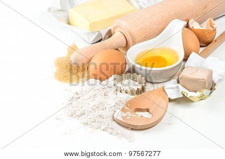 Flour, Eggs, Yeast, Sugar, Butter. Wooden Kitchen Utensils. Food Background
