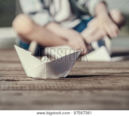 Close Up Image Paper Ship On The Wooden Pier