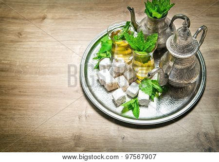 Tea With Mint Leaves And Arabic Delight. Oriental Hospitality