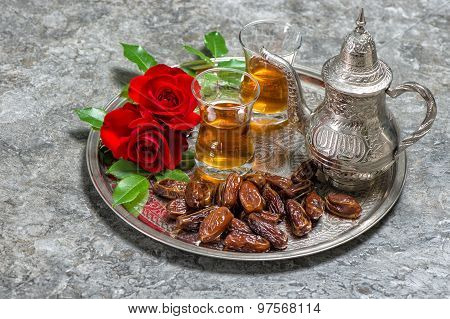 Tea, Dates Fruits And Red Rose Flowers. Islamic Holidays Decoration. Ramadan