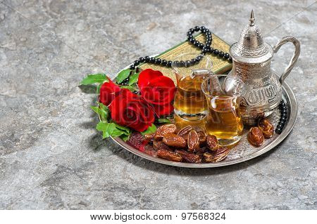 Tea, Dates Fruits, Red Rose Flower, Holy Book Quran And Rosary. Islamic Holidays
