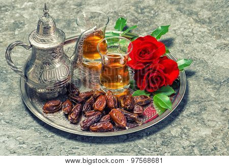 Tea, Dates Fruits And Red Rose Flowers. Oriental Hospitality Concept