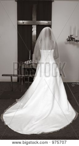 Bride At Alter With Cross